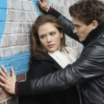 Couple conflict on street Leaning On Wall