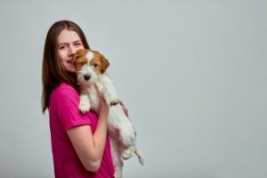 woman-hugging-jack-russell-terrier-hands